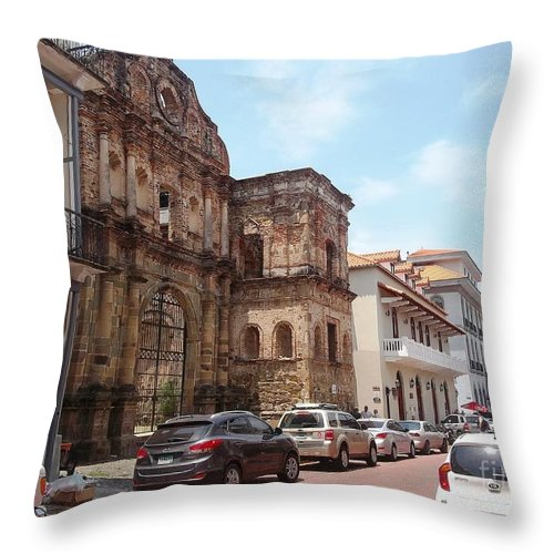 Colonial Street Throw Pillow featuring the photograph A Street In The Old Quarter. by Vladimir Berrio Lemm