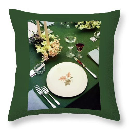 Nobody Throw Pillow featuring the photograph A Table Setting On A Green Tablecloth by Haanel Cassidy