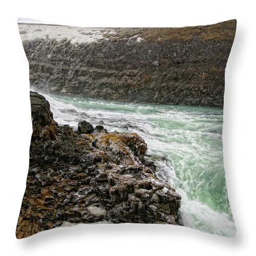 Gullfoss Waterfall Throw Pillow featuring the photograph A Tourist Takes A Photo At Gullfoss by Marc Pagani