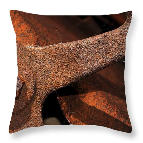 Wheel Throw Pillow featuring the photograph A Very Rusty Steering Wheel by Phyllis Denton