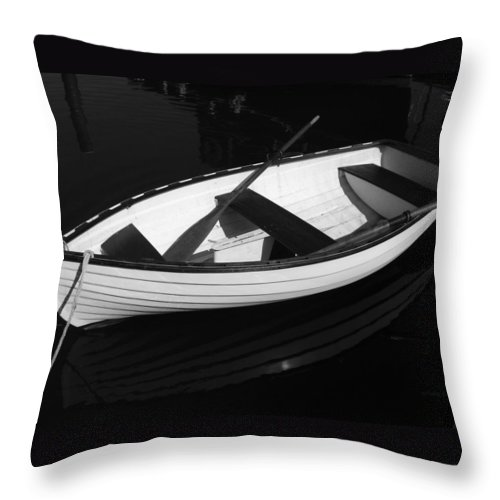 Boats Throw Pillow featuring the photograph A White Rowboat by Xueling Zou