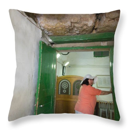 A Woman Entering The Tomb Of The Patriarchs Throw Pillow featuring the photograph A Woman Entering The Tomb Of The Patriarchs by Esther Newman-Cohen