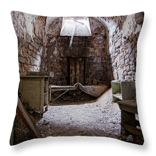 Eastern State Penitentiary Throw Pillow featuring the photograph Abandoned Cell 2 by Michael Dorn