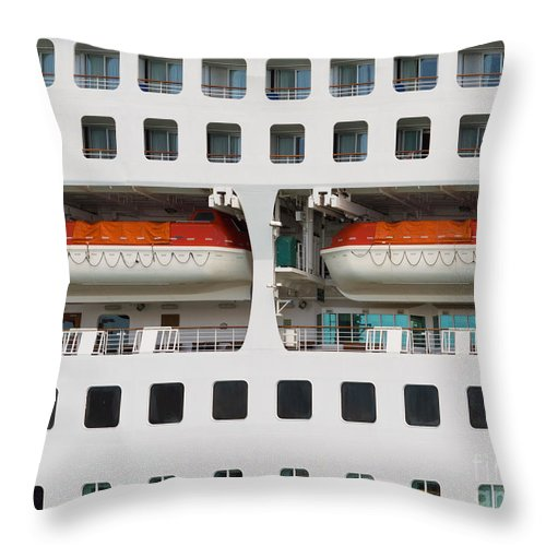 Abandon Throw Pillow featuring the photograph Abstract Of Lifeboats On A Large Cruise Ship by Stephan Pietzko