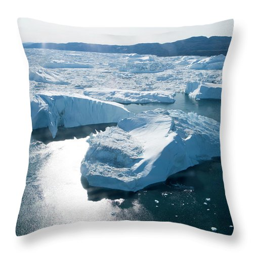 Melting Throw Pillow featuring the photograph Aerial Of Icebergs Of Ilulissat by Holger Leue