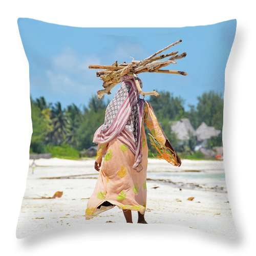 People Throw Pillow featuring the photograph African Girl With A Bundle Of Reeds On by Volanthevist