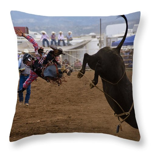 Rodeo Throw Pillow featuring the photograph Airborne by Patrick Moore