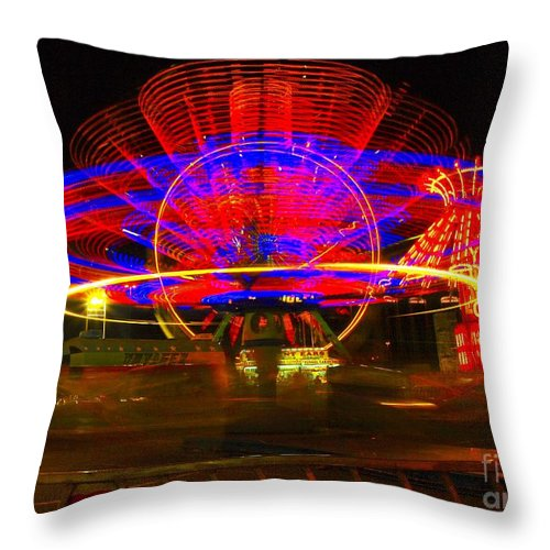 Night Photos Throw Pillow featuring the photograph All The Rides Moving At Once by Jeff Swan