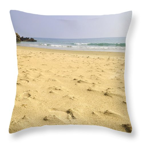 Seascape Throw Pillow featuring the photograph Alone At Bolonia Beach by Guido Montanes Castillo