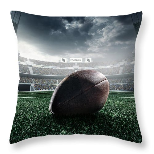 Event Throw Pillow featuring the photograph American Football Ball by Dmytro Aksonov