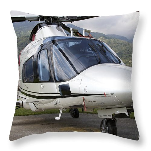 Switzerland Throw Pillow featuring the photograph An Agustawestland A109 Power Elite by Luca Nicolotti