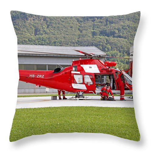 Switzerland Throw Pillow featuring the photograph An Agustawestland Aw109 Helicopter by Luca Nicolotti