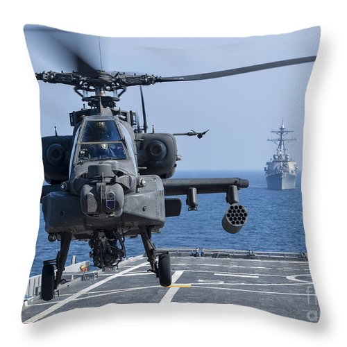 Military Throw Pillow featuring the photograph An Army Ah-64d Apache Helicopter Takes by Stocktrek Images