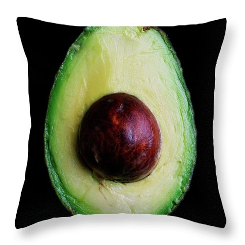 Fruits Throw Pillow featuring the photograph An Avocado by Romulo Yanes