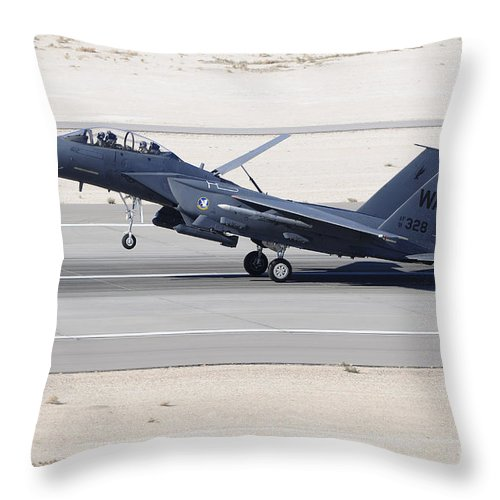 Horizontal Throw Pillow featuring the photograph An F-15c Eagle Landing On The Runway by Remo Guidi