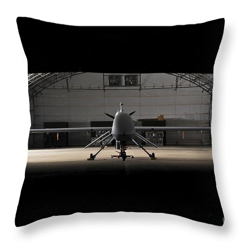 Mq-1c Sky Warrior Throw Pillow featuring the photograph An Mq-1c Sky Warrior Uav Parked by Stocktrek Images