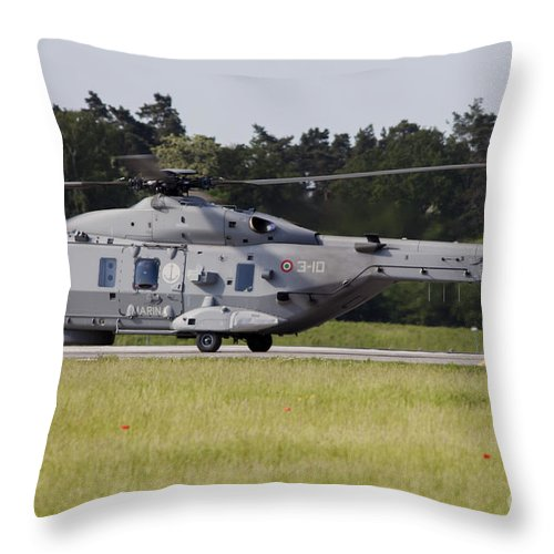 Berlin Throw Pillow featuring the photograph An Nh90 Helicopter Of The Italian Navy by Timm Ziegenthaler