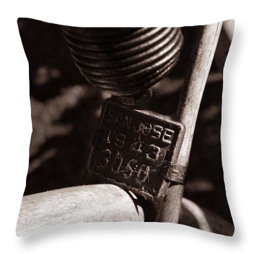 Bicycle Throw Pillow featuring the photograph An Old Rusty Bicycle by Xueling Zou