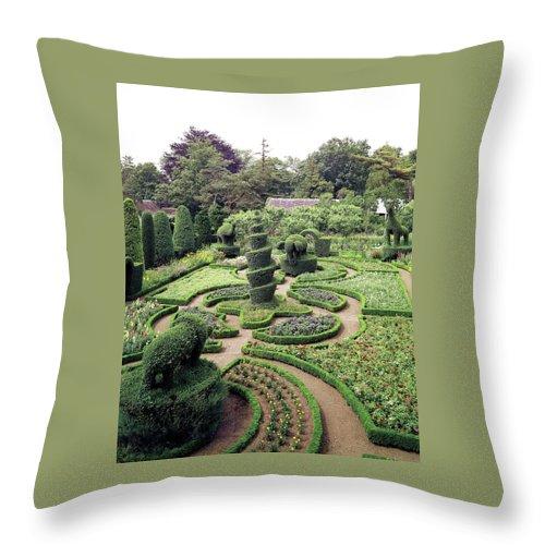 Exterior Throw Pillow featuring the photograph An Ornamental Garden by Tom Leonard