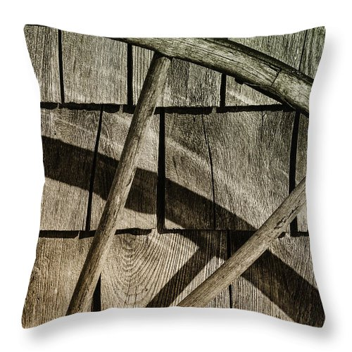 Wheel Throw Pillow featuring the photograph And The Big Wheel Goes Around by Susan Capuano