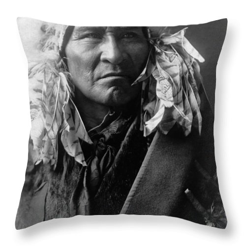 1908 Throw Pillow featuring the photograph Apsaroke Indian Man Circa 1908 by Aged Pixel