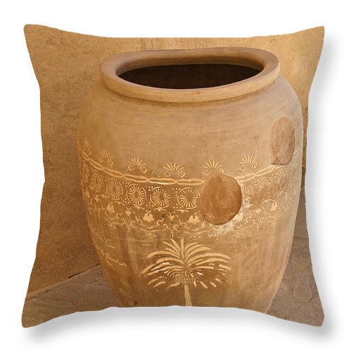 Africa Throw Pillow featuring the photograph Arabian Pottery by Michele Burgess