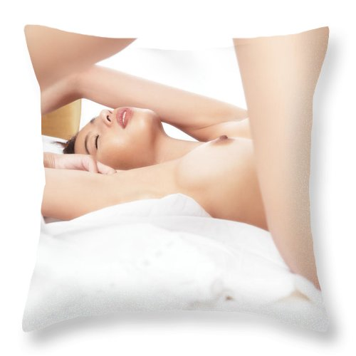 Naked Throw Pillow featuring the photograph Artistic Sensual Closeup Of Nude Woman Lying In Bed by Oleksiy Maksymenko