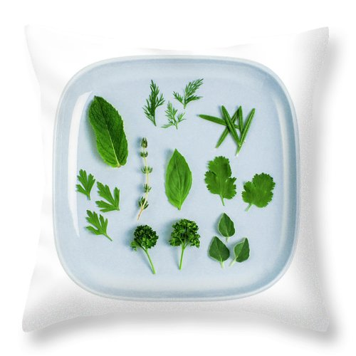White Background Throw Pillow featuring the photograph Assorted Fresh Herb Leaves On Blue Plate by Creative Crop