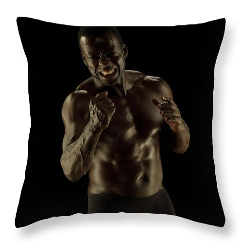 Toughness Throw Pillow featuring the photograph Athletic Female, Angry Shout, Clenched by Jonathan Knowles