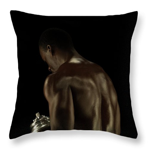 Mature Adult Throw Pillow featuring the photograph Athletic Male Exercising With A Hand by Jonathan Knowles