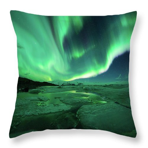 Glacier Lagoon Throw Pillow featuring the photograph Aurora Display Over The Glacier Lagoon by Natthawat