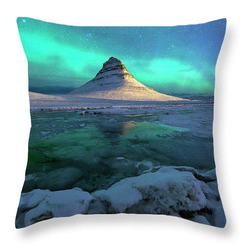 Tranquility Throw Pillow featuring the photograph Aurora Over Kirkjufell Mountain Iceland by Ratnakorn Piyasirisorost