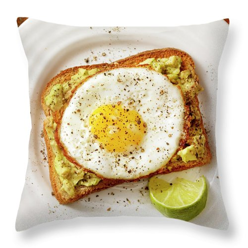 Breakfast Throw Pillow featuring the photograph Avocado Toast With A Fried Egg by Lauripatterson