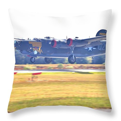 9122 Throw Pillow featuring the photograph B-24 Landing by Gordon Elwell