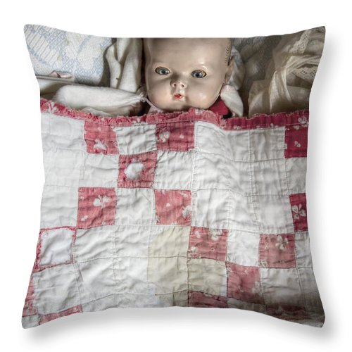 Old; Antique; Childhood; Doll; Eerie; Eyes; Face; Gazing; Heirloom; Nostalgia; Old; Retro; Staring; Toy; Vintage; Female; Male; Girl; Boy; Porcelain; Eyes; Blanket; Bed; Crib; Play; Playing; Quilt; Baby Throw Pillow featuring the photograph Baby Doll by Margie Hurwich