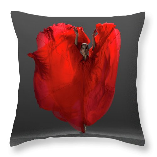 Ballet Dancer Throw Pillow featuring the photograph Ballerina On Pointe With Red Dress by Nisian Hughes