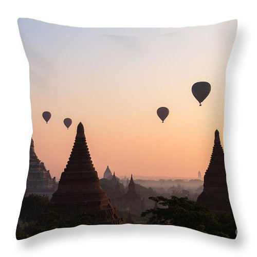 Dawn Throw Pillow featuring the photograph Ballons Over The Temples Of Bagan At Sunrise - Myanmar by Matteo Colombo