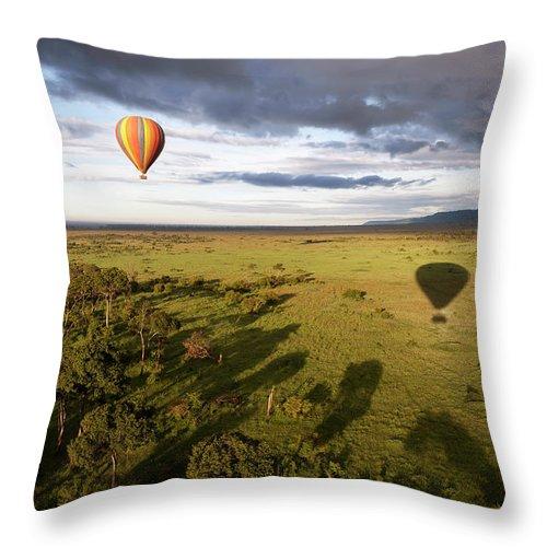 Kenya Throw Pillow featuring the photograph Balloon In Masai Mara National Park by Luis Davilla