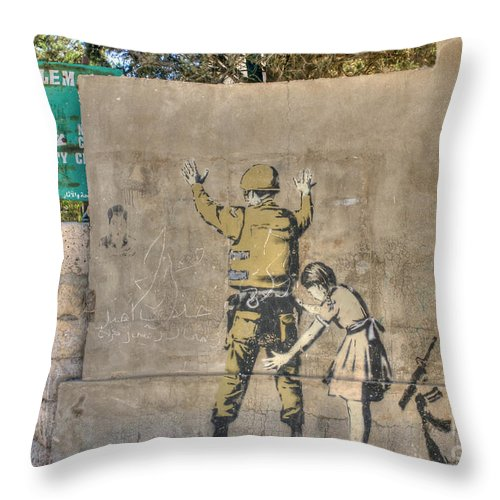 Banksy Throw Pillow featuring the photograph Banksy In Bethlehem 2 by David Birchall