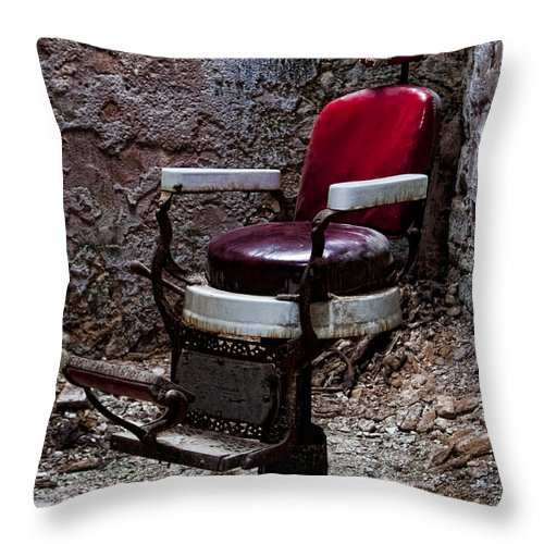 Eastern State Penitentiary Throw Pillow featuring the photograph Barber Chair by Michael Dorn