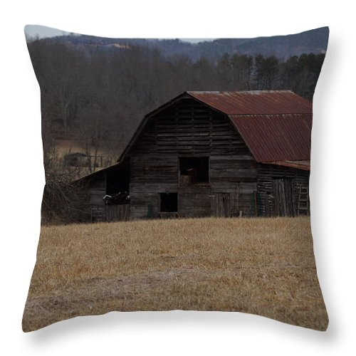 Western Throw Pillow featuring the photograph Barn Across The Field by John Wall