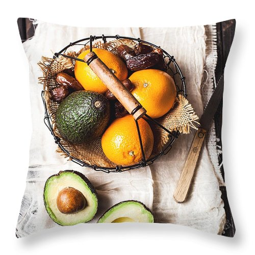 San Francisco Throw Pillow featuring the photograph Basket With Avocado, Oranges And Dates by One Girl In The Kitchen