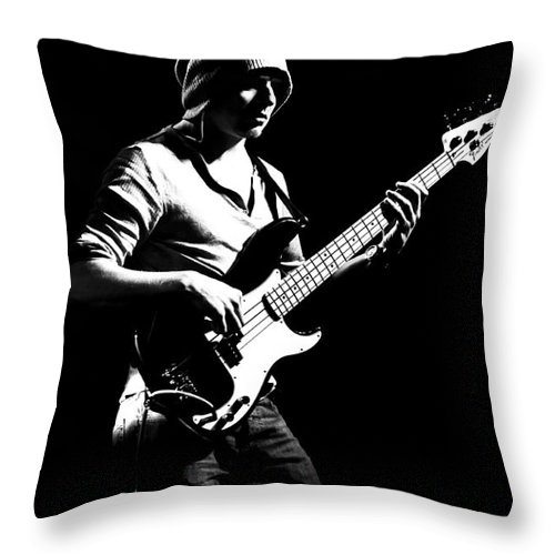 Gig Throw Pillow featuring the photograph Bassist by Julian Eales