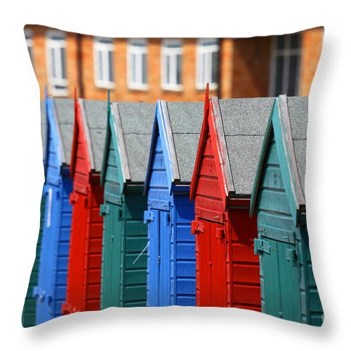 England Throw Pillow featuring the photograph Beach Huts 1 by James Brunker
