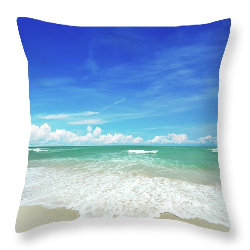 Tranquility Throw Pillow featuring the photograph Beach by Photo By Arztsamui
