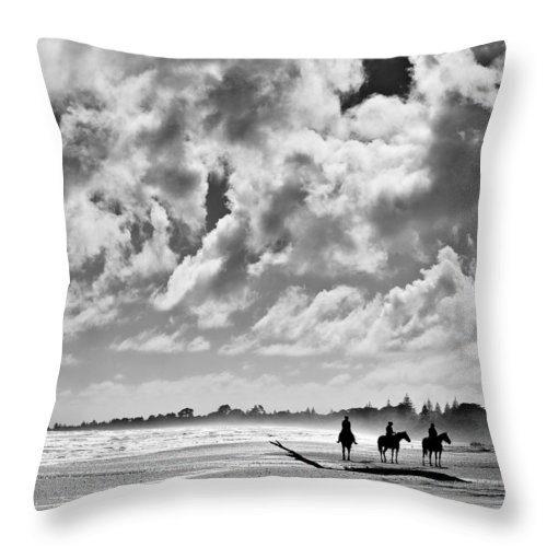 Ride Throw Pillow featuring the photograph Beach Riders by Dave Bowman