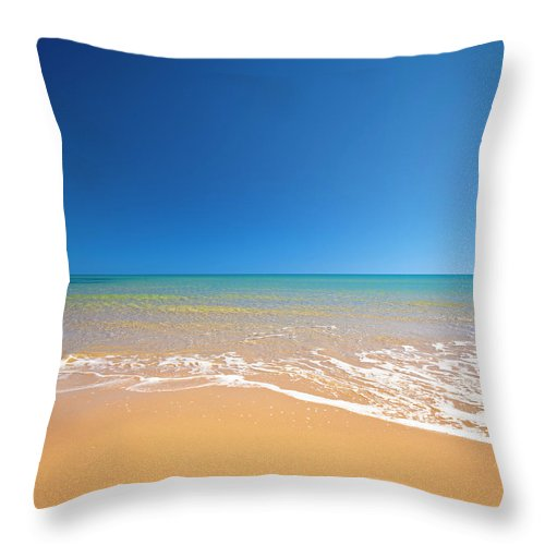 Wind Throw Pillow featuring the photograph Beach by Spooh