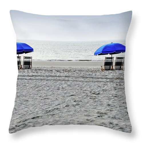 Hilton Head Throw Pillow featuring the photograph Beach Umbrellas On A Cloudy Day by Thomas Marchessault