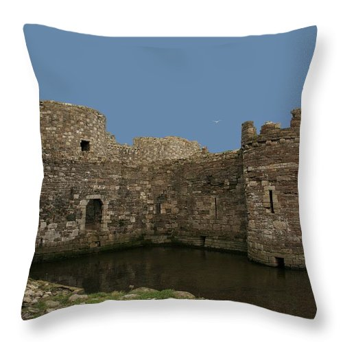 Castles Throw Pillow featuring the photograph Beamaris Castle by Christopher Rowlands