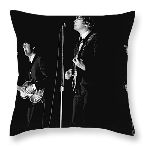Beatles Throw Pillow featuring the photograph Beatles In Concert, 1964 by Larry Mulvehill